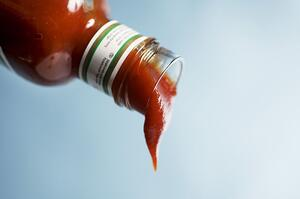 Ketchup flowing out of bottle